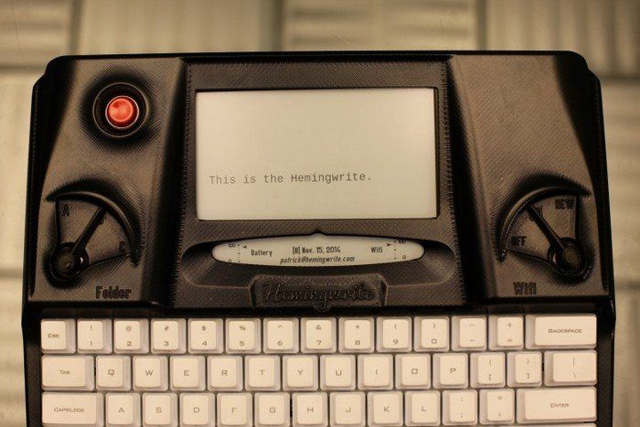 "Close-up of Hemingwrite; screen reads: ""This is the Hemingwrite."" Blogged on Typewriter Poetry."