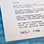 """Etsy Typewriter Poetry Poem """"Spring."""" Dutch angle against blue wood card stock."""