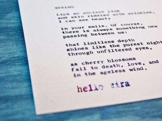 "Etsy Typewriter Poetry Poem ""Spring."" Dutch angle against blue wood card stock."