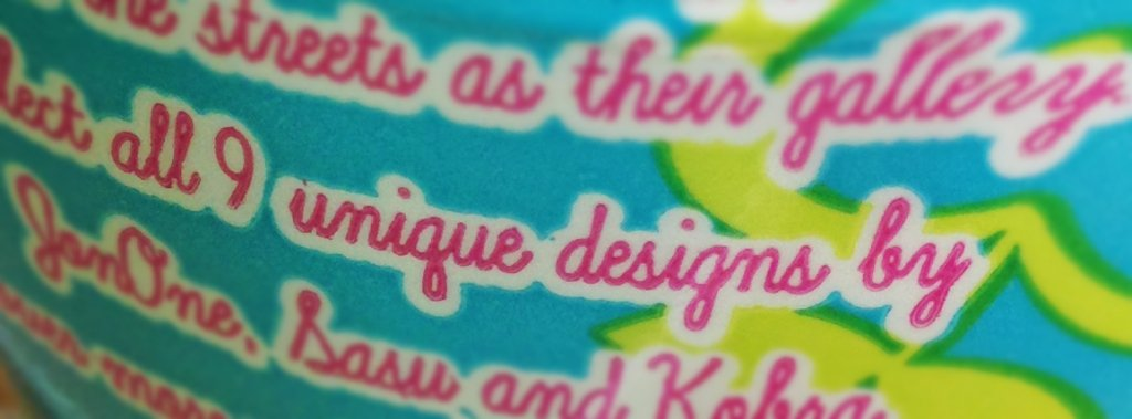 """Close-up of a Perrier water bottle: """"all 9 unique designs."""" Submission for #TyPoInPo 2015."""