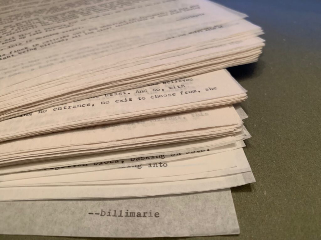 A stack of onionskined paper typewriter stories for Private Drafts by Billimarie Lubiano Robinson.