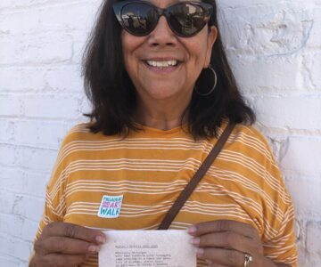 """Poem for Evelyn"" - Evelyn holding her Typewriter Poetry poem at the Pasadena ARTWalk"